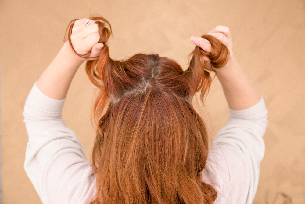 Brush hair. Part your hair at the crown from ear to ear. Divide in half, clip one side out of the way.