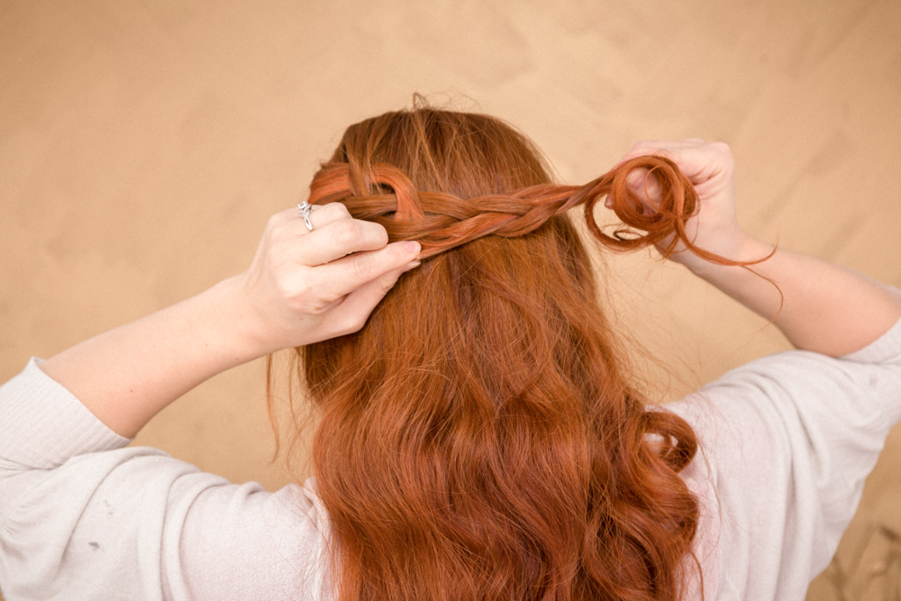 Lightly pull on each braided strand to loosen/deconstruct braid.