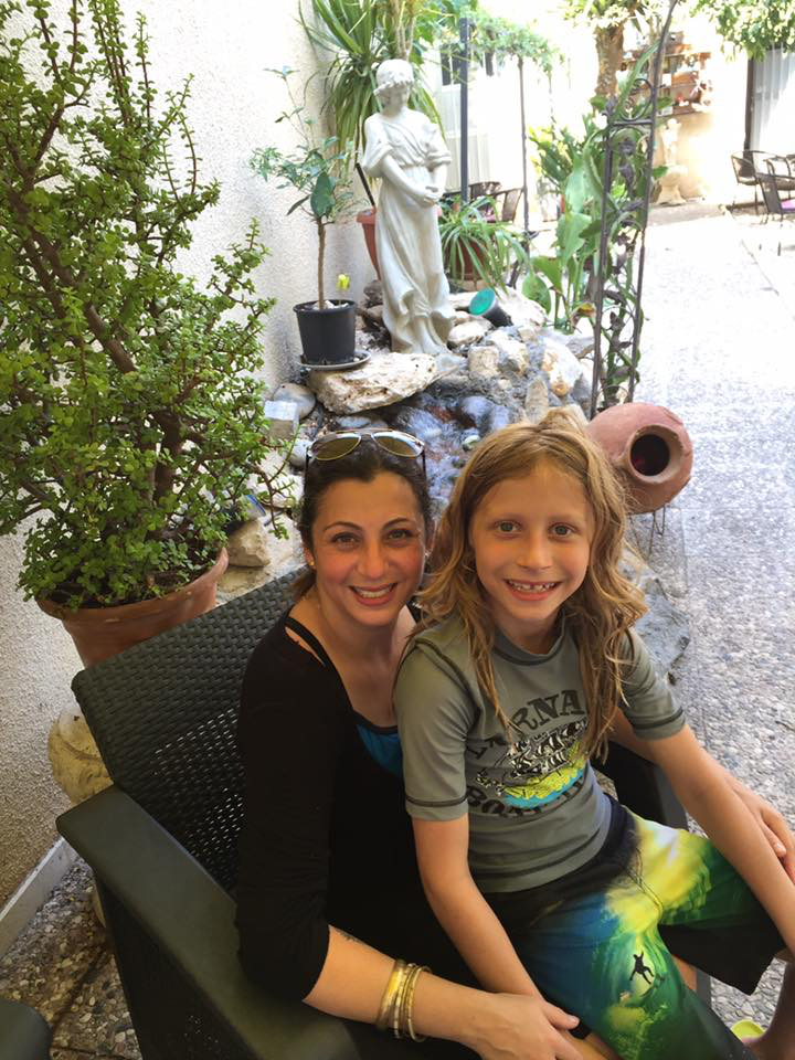 My son and I enjoying some quiet time at the Secret Garden in Larnaca, Cyprus, in August 2016.