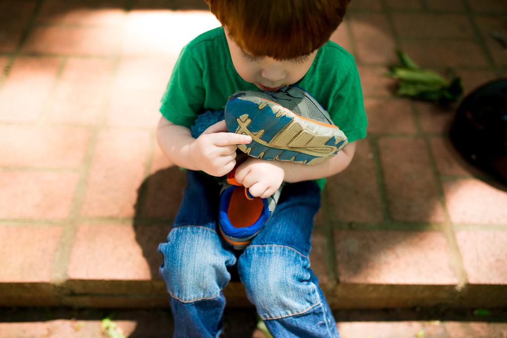 greensburg-family-photographer-boy-holding-shoes