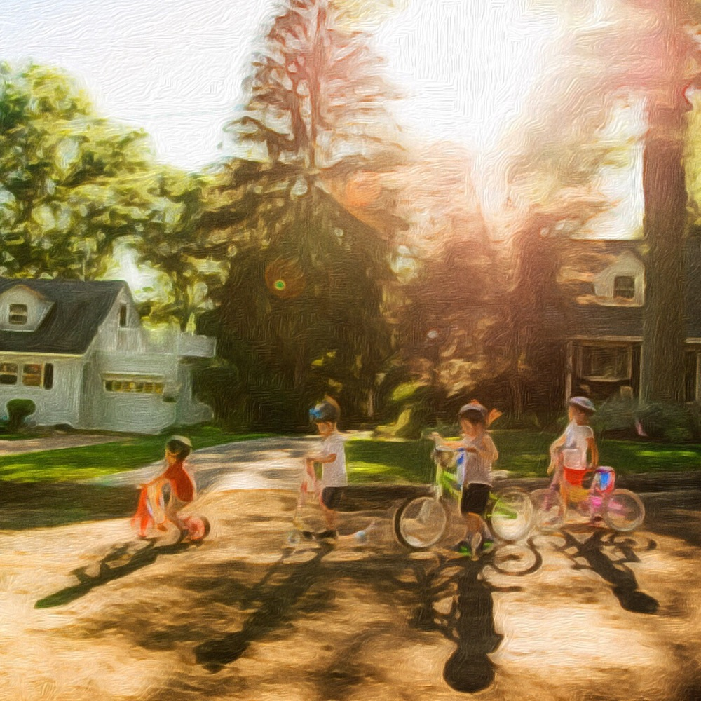 painting of kids on bikes at golden hour