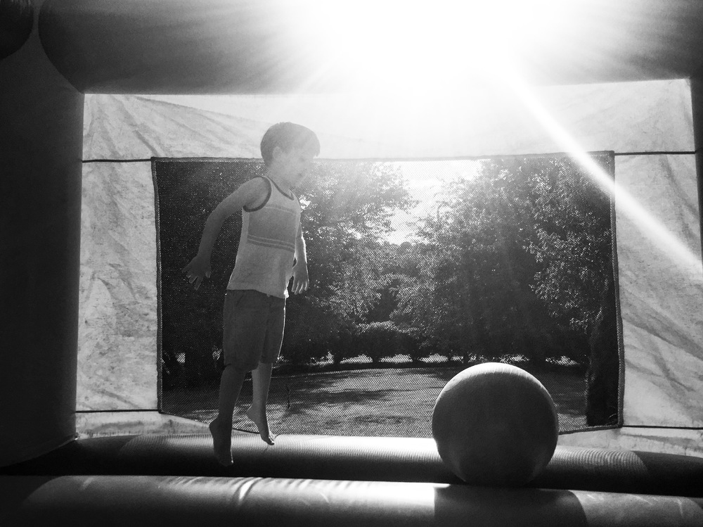 boy jumping in bouncy house