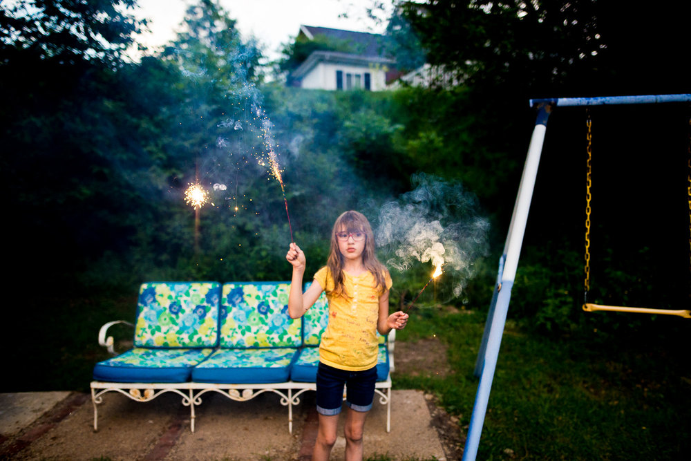 """The story of your summer nights growing up: the sprinkler, s'mores, and sparklers."""