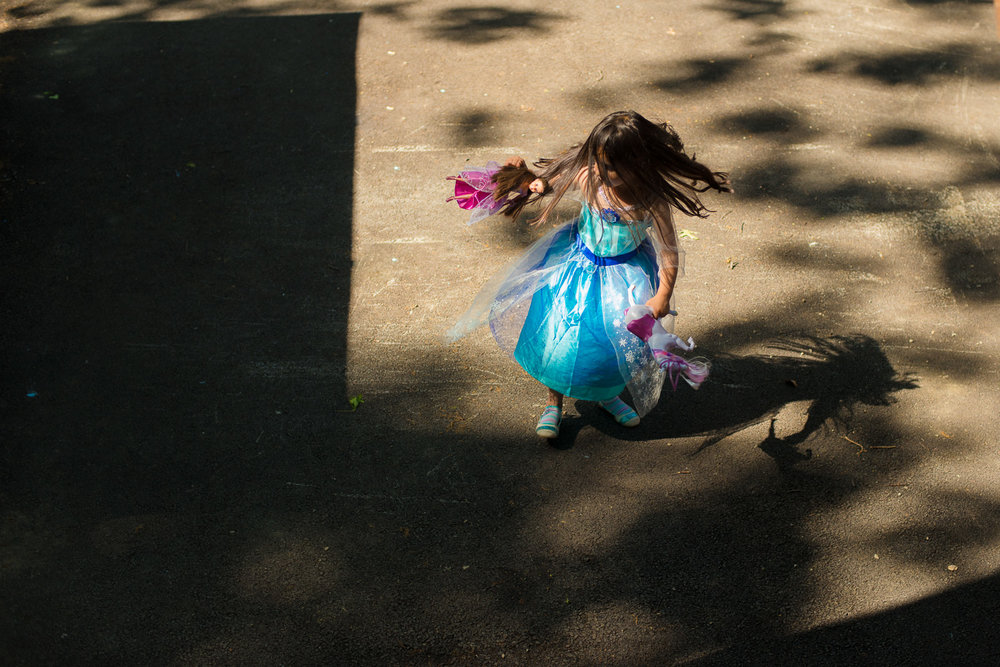 little girl dancing in princess dress