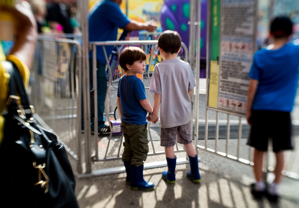 brothers-waiting-in-line-at-amusement-park