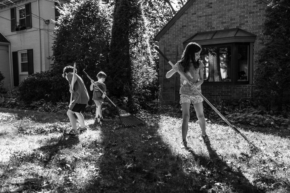 I almost chose this frame as the final image because it's as close as I got to my original intent: to have all three kids in the light. But I don't like how the two boys on the left are so close to each other and the middle rake is in shadow. The image does not feel balanced enough. -