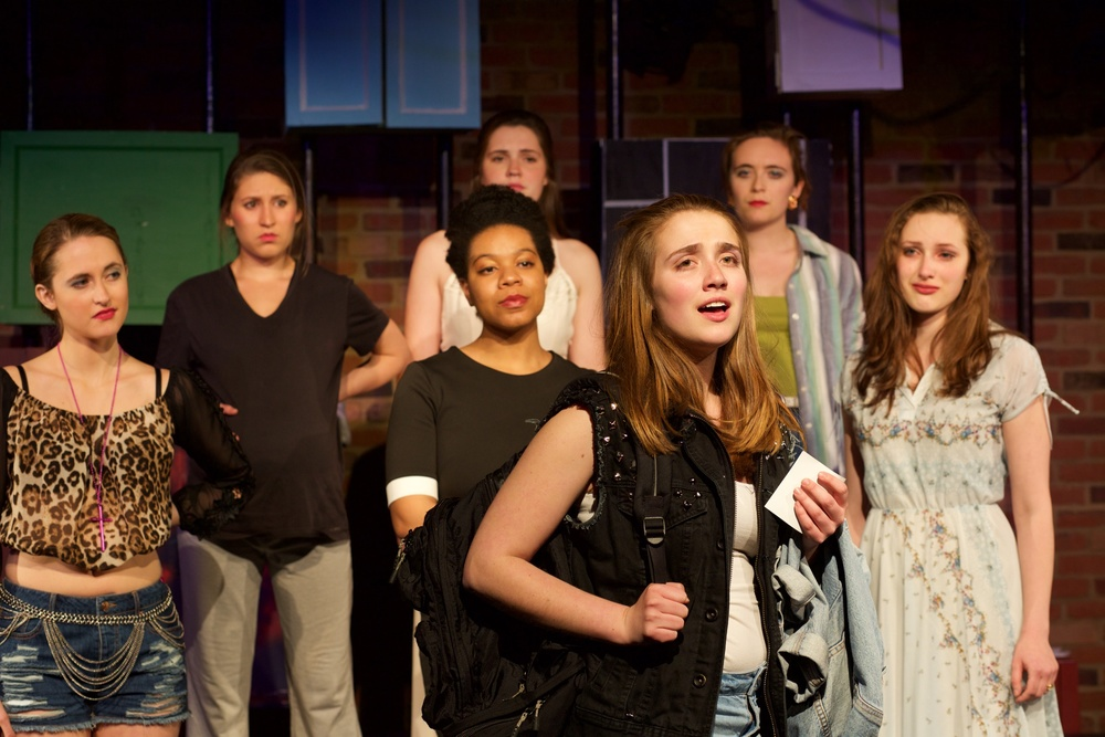 Astrid ( Sarah Chapin ) [ foreground ];  background, from L to R:  Starr ( Lucie Ledbetter ), Yvonne ( Alyssa Miller ), Olivia ( Zina Ellis ), Ingrid ( Caroline Rouse ), Marvel ( Anya Richkind ), Claire ( Lucy Fleming ).