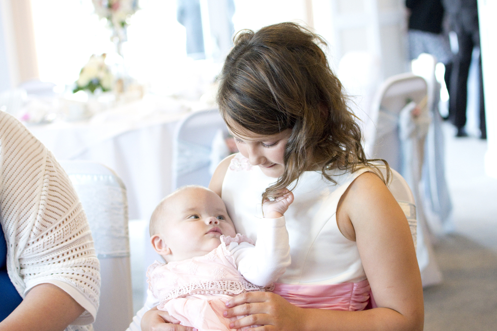 baby twiddling with little girls hair at The GreenBank Hotel Falmouth
