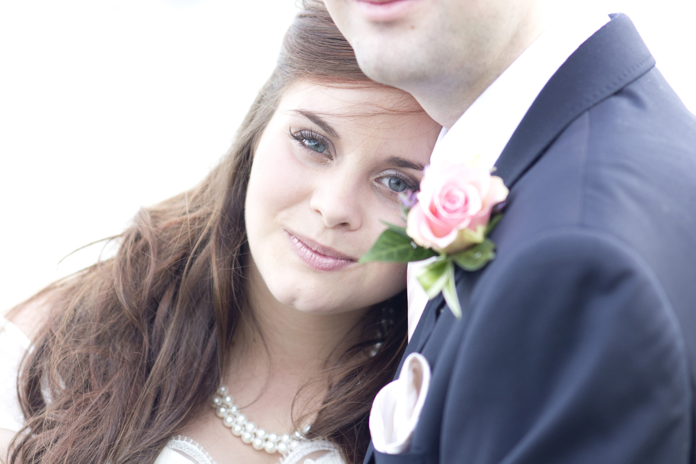 bride, blue eyes, eye lashes, groom with pink rose