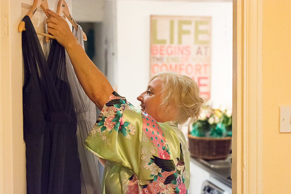 Mother of the bride hanging dress at truro home