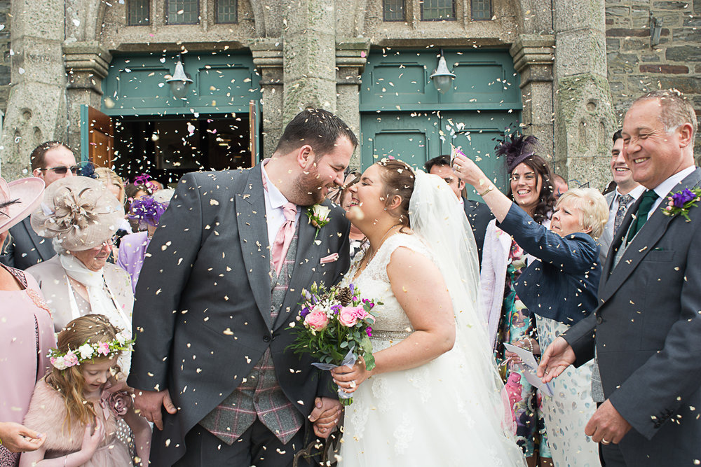 confetti and kisses outside the church in porthleven cornwall
