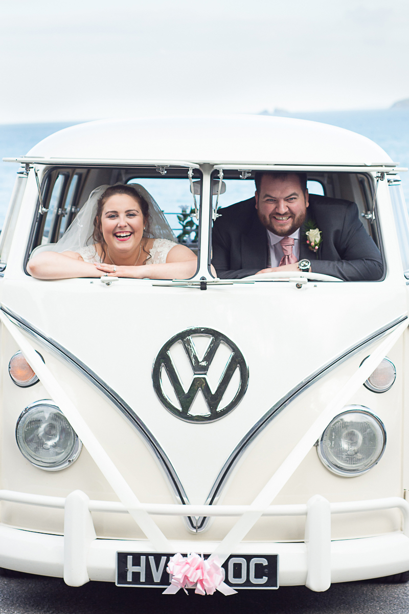 bride and groom in their campervan at the carbis bay hotel