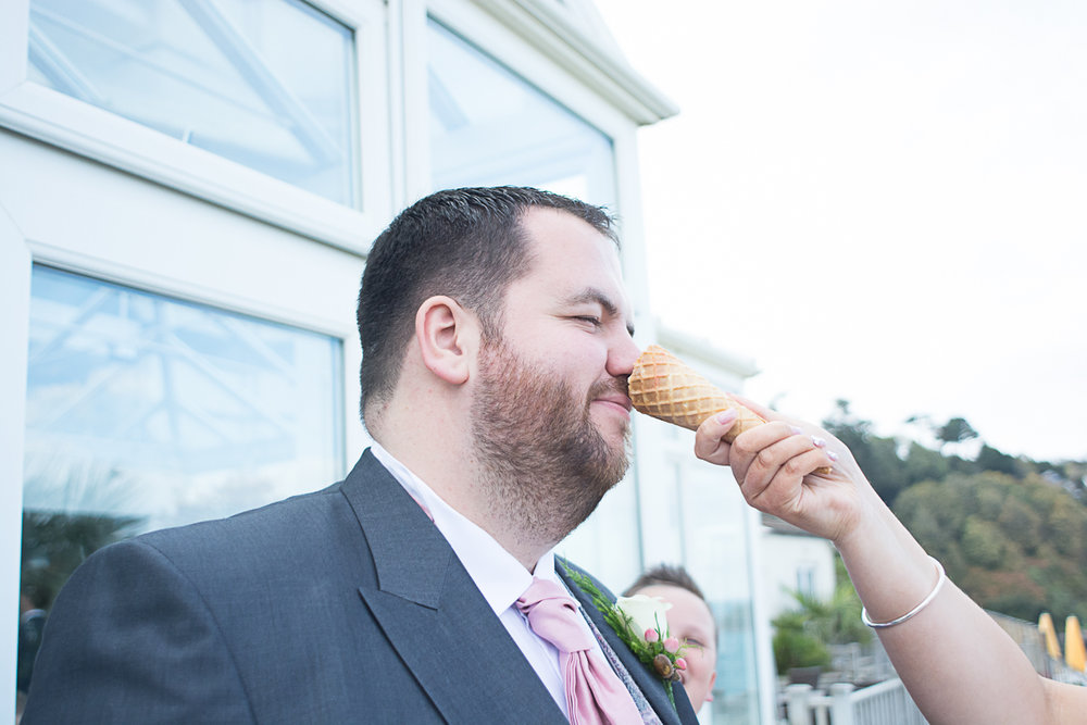 groom gets icecream on his nose at carbis bay cornwall