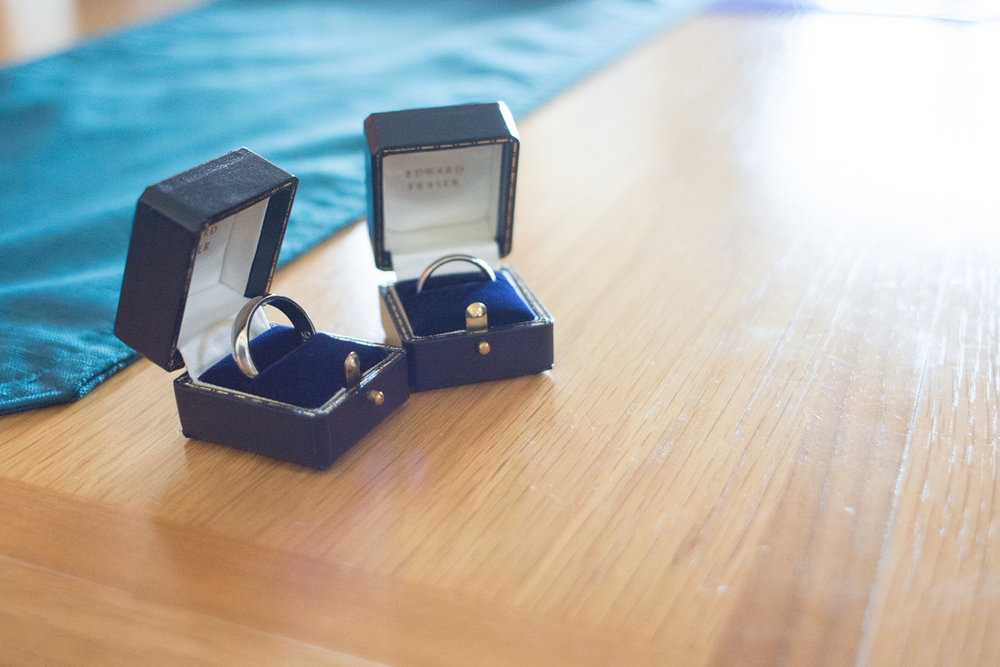 Caroline and Charlie's wedding rings at the whitsand bay fort