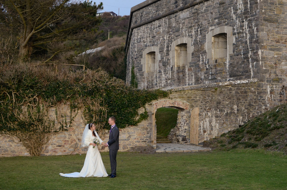 Bride and groom in front of the Polhawn fort.jpg