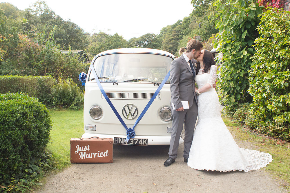 Bride and Groom, just married, cornish camper vans and kisses