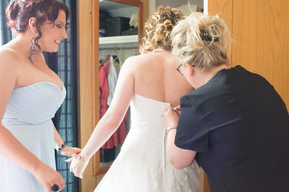 the bride getting into her dress on her atlantic hotel newquay wedding day
