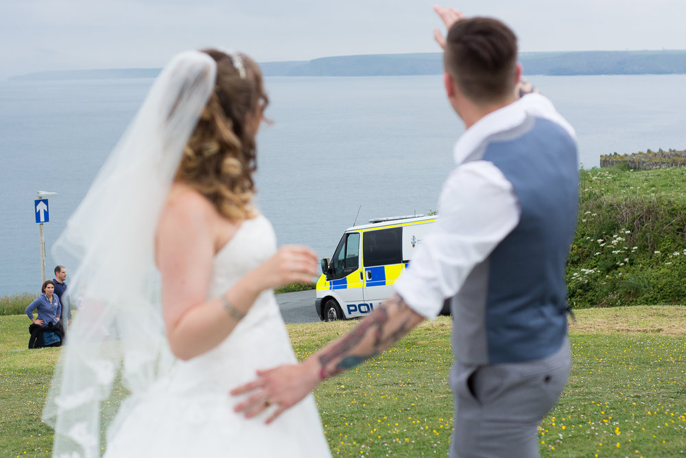 bride and groom wave to the police outside the Atlantic Hotel in Newquay