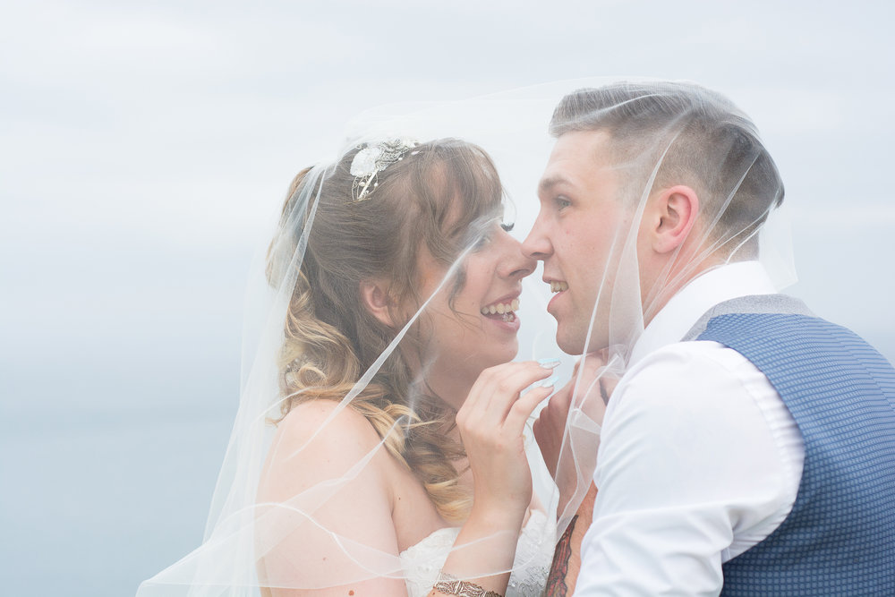 bride and groom share a moment together under the veil at their Atlantic Hotel Newquay wedding