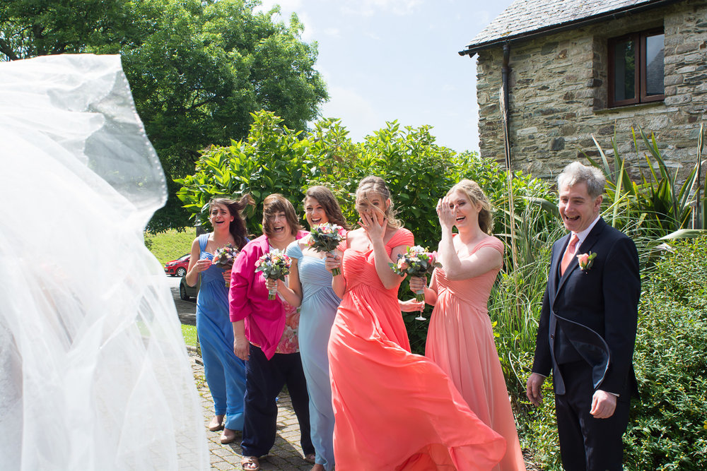 family reaction to the bride in her dress outside at boringdon hall