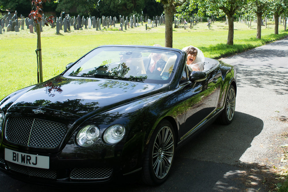 the bride arrives in style at st mary's church plympton plymouth