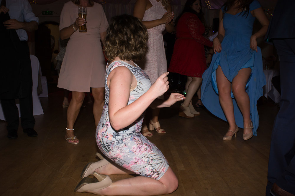 knee slide on the dancefloor at Boringdon Hall Plymouth wedding