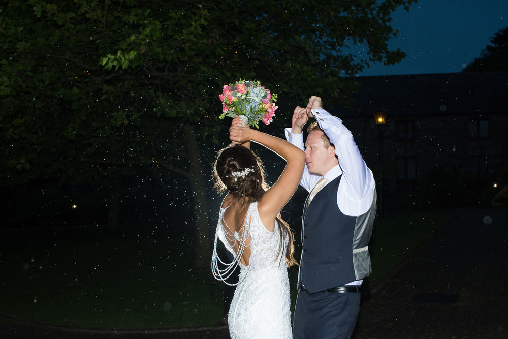 Dancing In the rain like Beyonce at Boringdon Hall Wedding