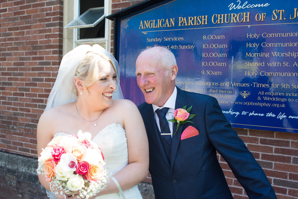 Becca and her dad have a quick photo outside the church in torquay