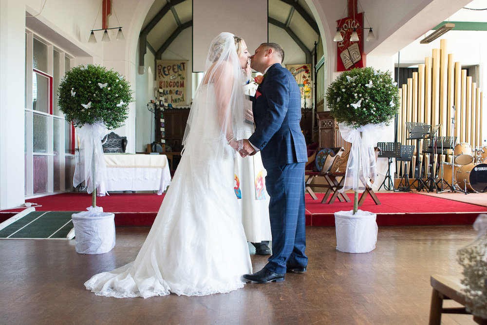 the first kiss at their torquay wedding