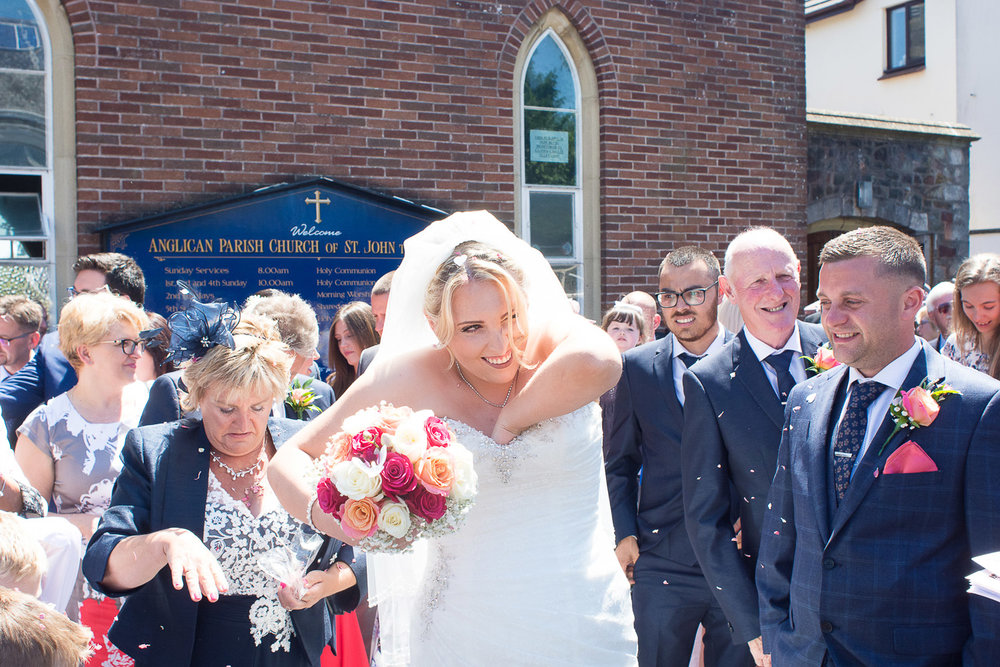 confetti gets down the brides dress outside the church in torquay
