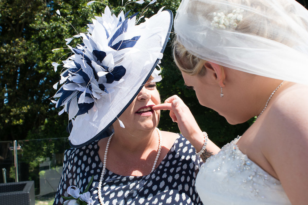 the bride picks herbs out of her mums teeth at the Headland Hotel Torquay
