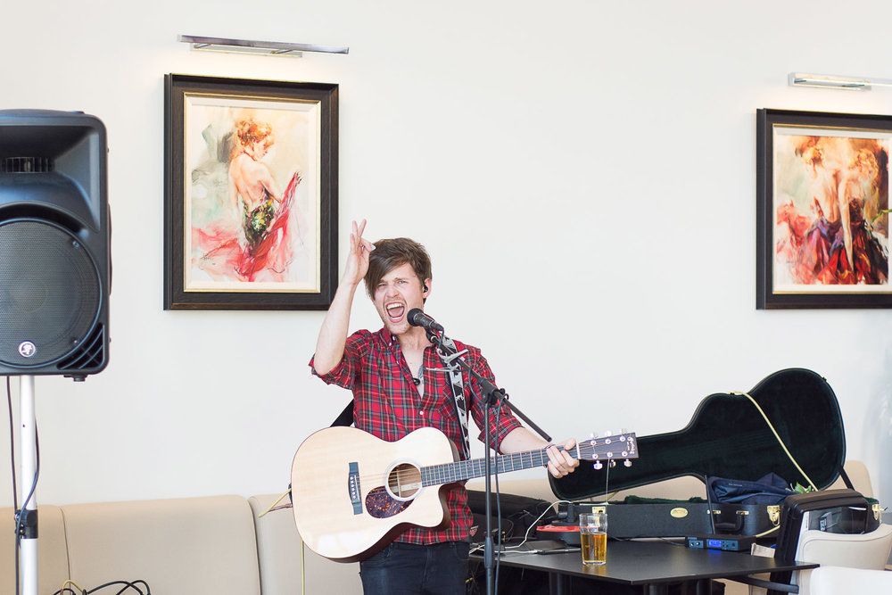 Rich Cottell singing and playing guitar at the Headland Hotel Torquay