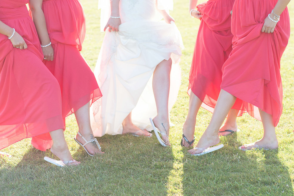 bride and bridesmaids show off their flip flops at the Headland Hotel Torquay