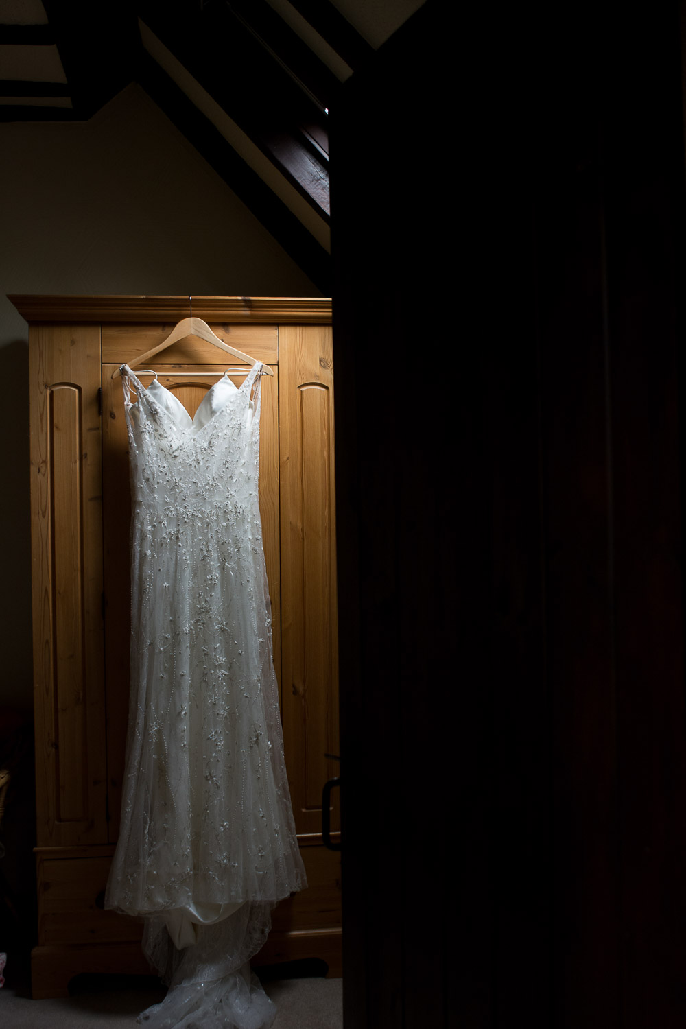 bohemian style dress hanging on the wardrobe at wedding yurts wedding in leicestershire