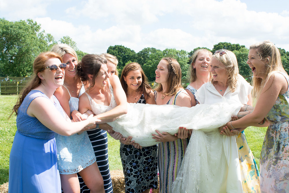 the girls pick up the bride at wedding yurts wedding in leicestershire