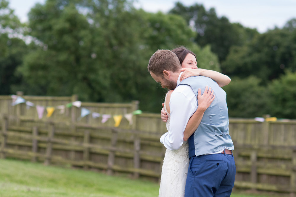 bride and groom have a tight hug at wedding yurts wedding in leicestershire