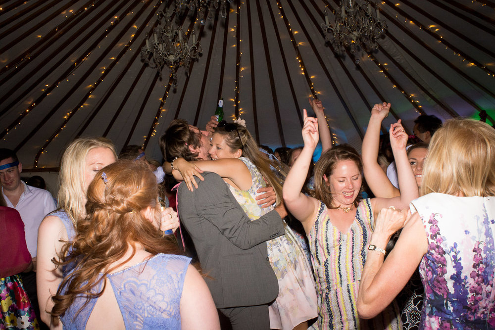 big hugs on the dancefloor at wedding yurts wedding in leicestershire