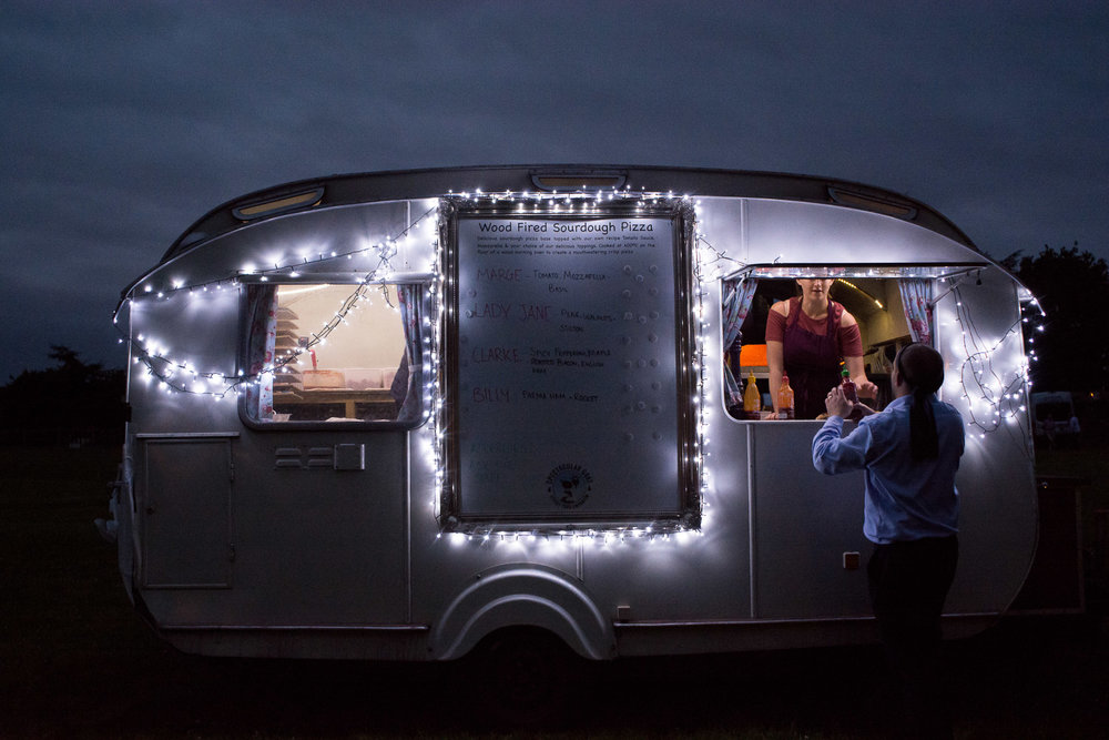 amazing wood fired pizza caravan at wedding yurts wedding in leicestershire