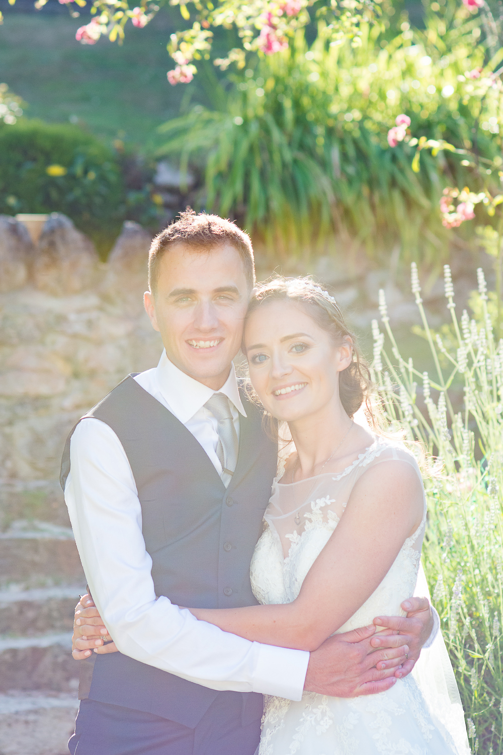 Beautiful Bride and Groom portrait in hazed light in the gardens at the Bickley Mill wedding venue in Devon