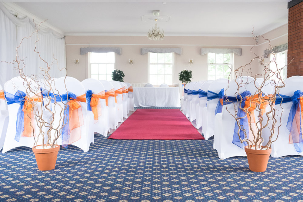 ceremony room decorated in orange and blue at the lord haldon hotel in devon