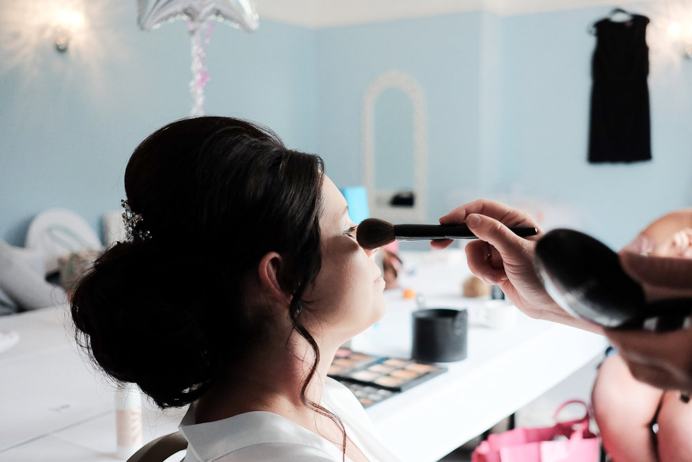 bride having makeup done at the lord haldon hotel in devon