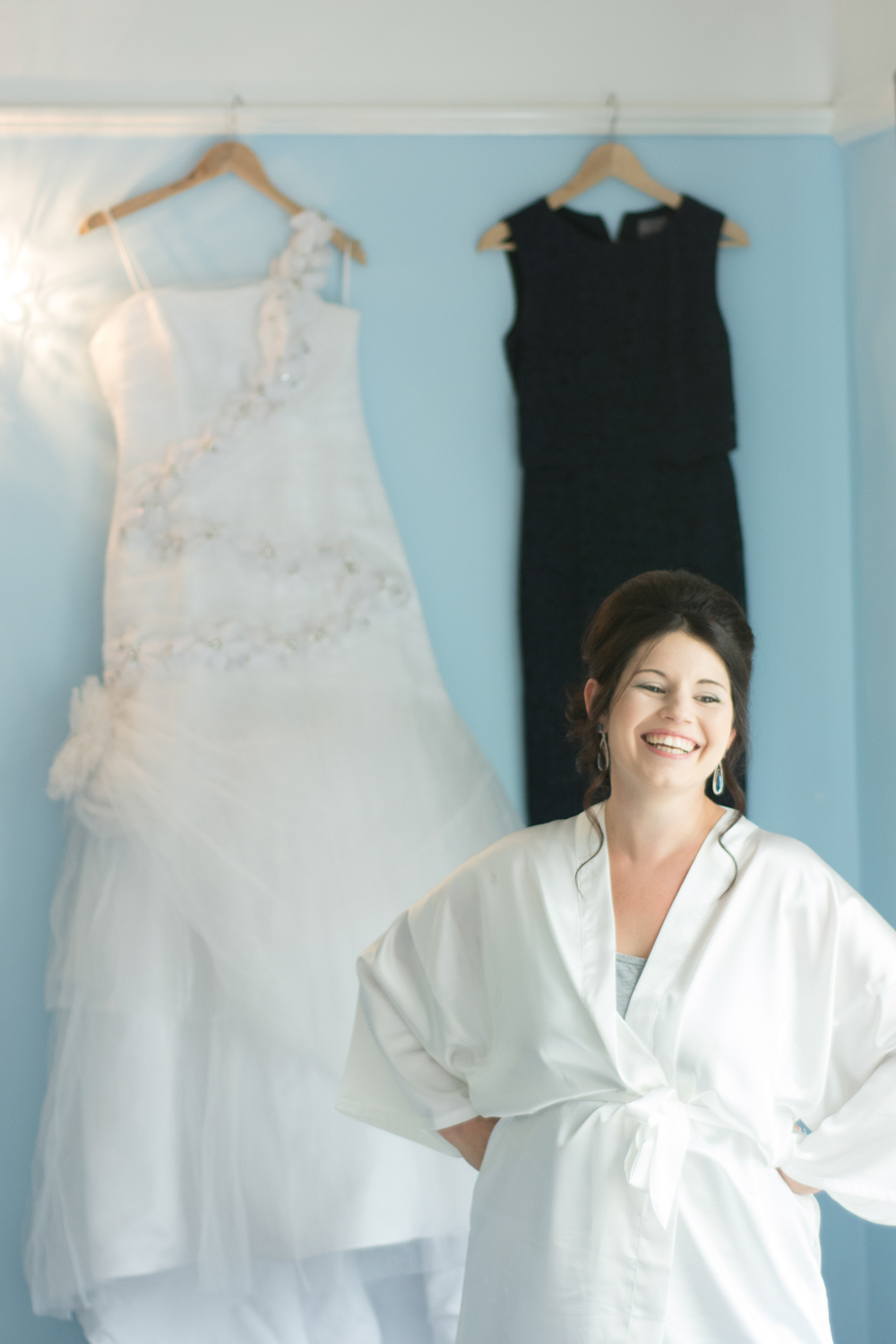 bride standing in front of her dress and smiling at The Lord Haldon Hotel in Devon