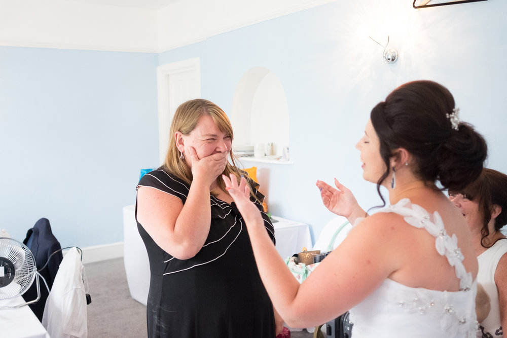 staff member at The Lord Haldon Hotel's reaction to the bride in her dress