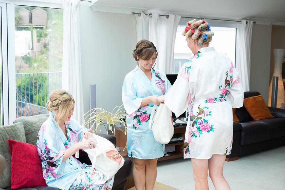 bride gives gifts to her bridesmaids in woolacombe devon