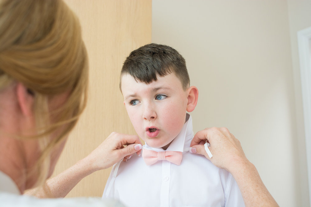 bride does her sons bow tie up in woolacombe devon