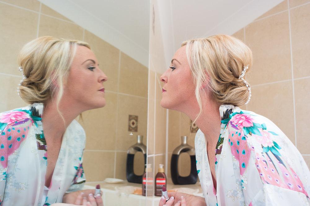 bride reflections applying lipstick in woolacombe devon