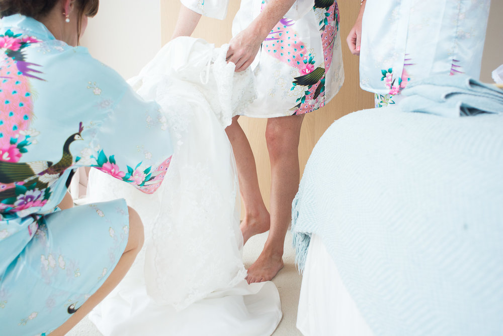 bride steps into dress in woolacombe, devon