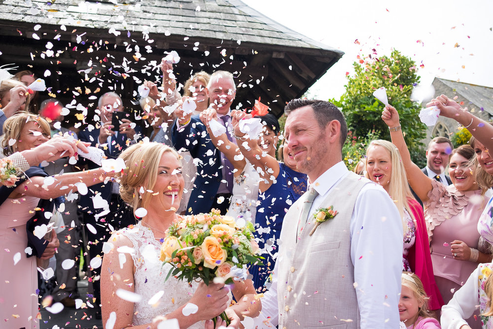 so much confetti outside st mary's church in woolacombe
