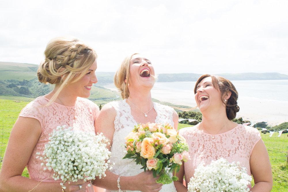 bride and bridesmaids laughing at woolacombe wedding