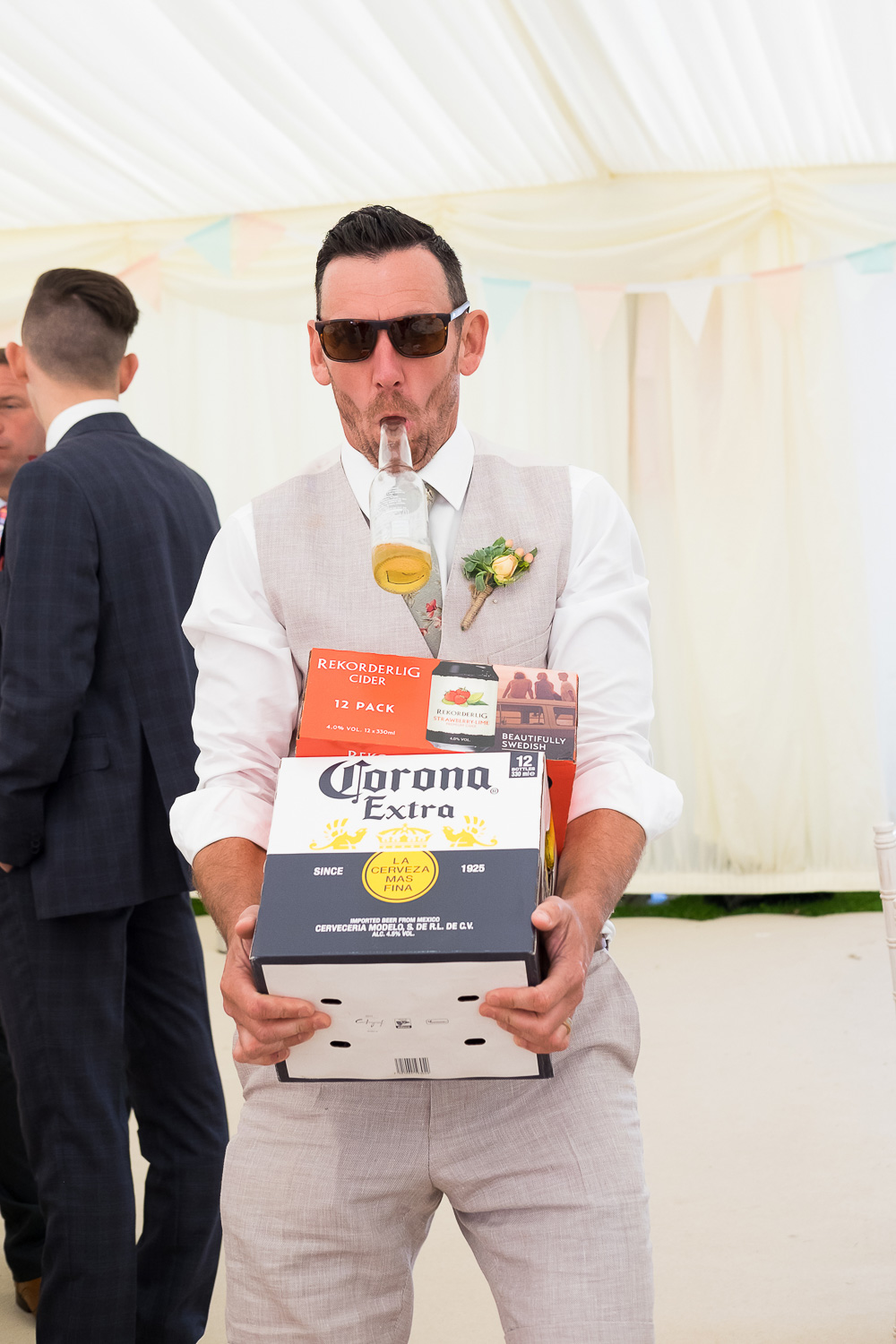 groom getting the bears in at festival wedding in woolacombe